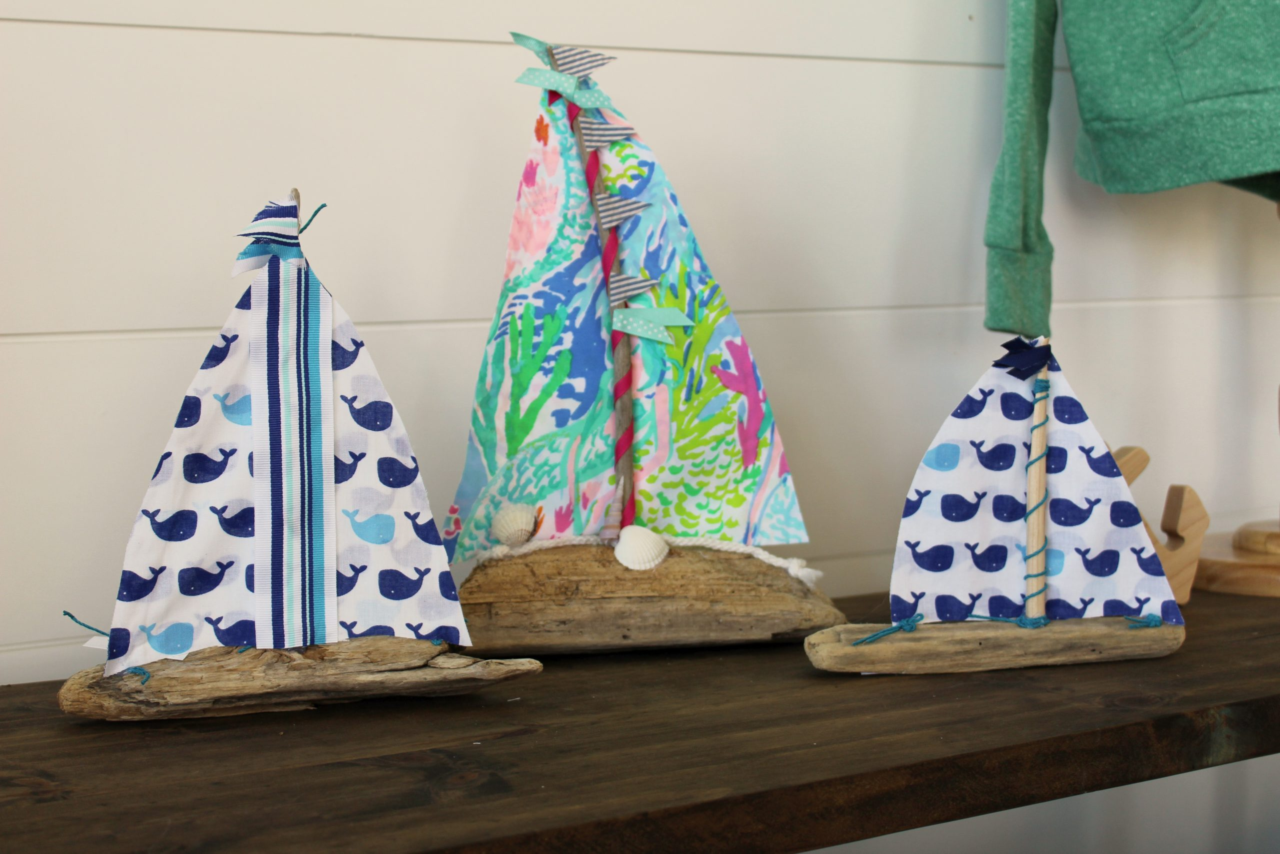 Image of driftwood sailboats